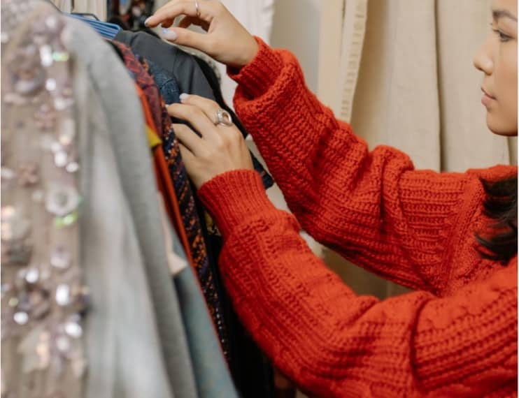 Woman looking through clothing on a rack